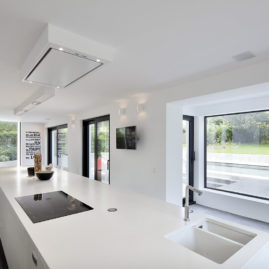 kitchen, with view of the garden and the pool
